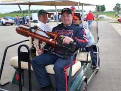 Brad Springer prepares to shoot t-shirts into the Angola Speedway grandstands with a t-shirt launcher.