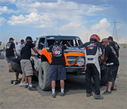 Team Jefferies pit crew works on the K&N Trophy Truck during a break in the grueling 276 mile SCORE Primm 300