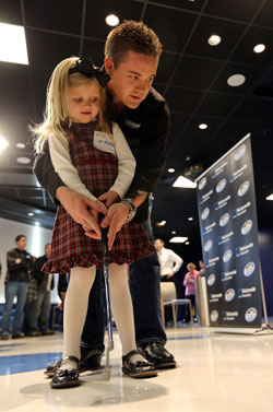 NASCAR Nationwide Series Champ Ricky Stenhouse Jr. plays putts with patient Taylor Rockwell