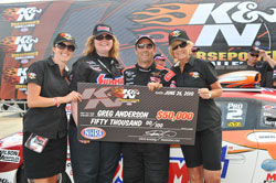 Stephanie Dunn and NHRA Pro Stock driver Greg Anderson accept Greg's winning check