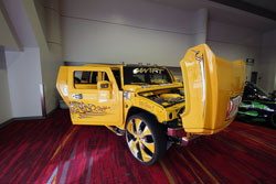 Sergio and his son picked out a huge set of Lexani Dial wheels for their custom Hummer and had the inserts painted to match. Photo at SEMA 2012.