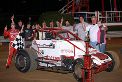 Kody and Tanner with their entire 6R racing team celebrating in Victory Lane.