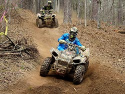Michael Swift attacks the trail on his Polaris UTV with Kevin Trantham close on his heels