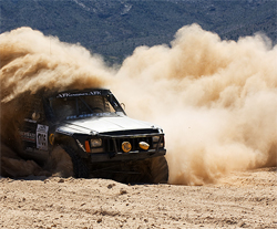 Torchmate Desert Truck surrounded by a plume of dust on the 250 mile off road course in Nevada, photo by Chad Jock Photography