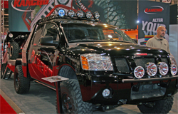 2008 Nissan Titan modified to haul a 2008 Polaris RZR 800 at the SEMA Show