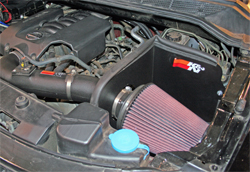 K&N air intake kit 63-6012 on 2008 Nissan Titan in Rancho Suspension Booth at SEMA Show in Las Vegas, Nevada