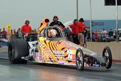 Not the car he built for 8.90 racing, Phillips takes his bracket dragster to the Quick Rod final in its first event. Photos by: IHRA Communications.