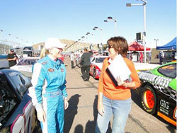 Toni McCray is continually learning from other racers, here she is sharing a laugh with 1992 Indianapolis 500 Rookie of The Year, Lynn St. James.