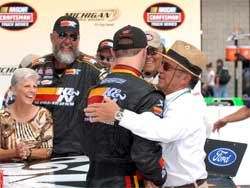 Owner Jack Roush congratulates Travis Kvapil