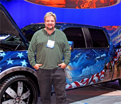 Artist Mickey Harris created a series of murals over the dark blue 2009 Ford F-150 to honor American soldiers.