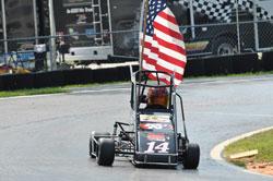 Tyler Clem taking his flag lap