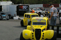 Hughes drives the No. 83 car, a 1934 Ford coupe, and teammate Mike Weddell drives the 1934 Ford sedan.