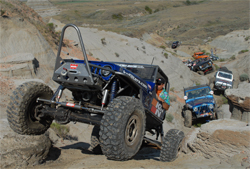 Caravan of off-road vehicles make it through tough off-road terrain in the Ultimate Adventure