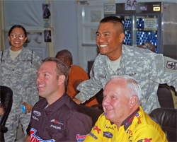 NHRA Pro Stock Champions Warren Johnson and Jason Line pose with American soldiers in Kuwait