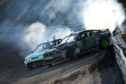 Vaughn Gittin Jr. was sweeping the bank and scraping the wall, leaving his rear bumper in the blue tire smoke on route to victory.