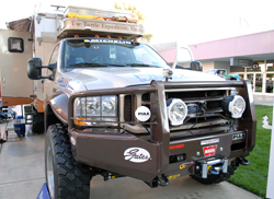 Gary and Monika Wescott's Ford F-550 with a custom camper shell at the 2011 SEMA Show