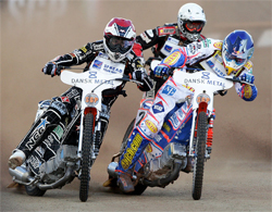 Australian Jason Crump, Sweden's Niels Kristian Iversen and Poland's Grzegorz Walasek at Vojens Stadium in Denmark
