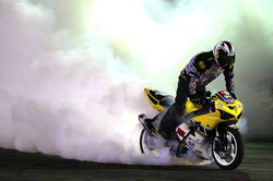 Brian Bubash performs motorcycle burnout
