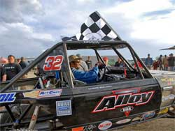 Roger Lovell with the checkered flag after his big win