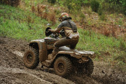 UTV and ATV racer Zac Zakowski working his off-road 2013 Can-am Commander 1000 through the trails