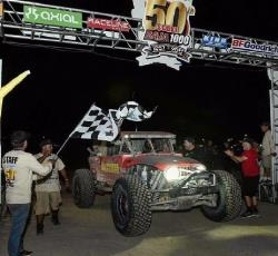 Adler and Team 4 Wheel Parts at the checkered flag of the Baja 1000