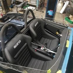 Custom narrow Sparco vintage style seats were installed in the snug confines of the Bugeye's coc