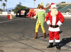 Santa and elf on track at orange show speedway