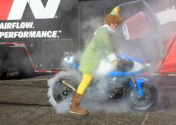 One of Santa's elves doing a burnout on his 2002 Suzuki TL1000R at Orange Show Speedway