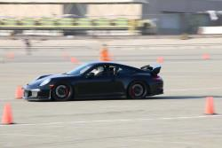 Photo of Scott Fraser on track behind the wheel of the Porsche GT3