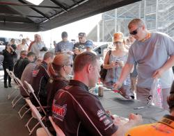 drivers meet fans and sign autographs at the K&N display trailer