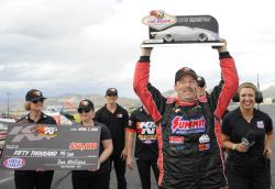 Greg Anderson lifts the trophy and celebrates at the K&N HPC