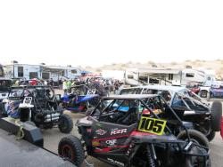 UTV race machines parked at a pre-race BBQ in the UTVWC pits