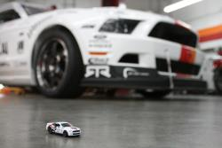 K&N's custom-built Ford Shelby GT500 Mustang race car posing with the 1/64 Hot Wheels die-