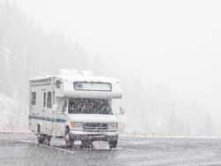 RV parked in a snowstorm