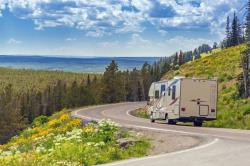Scenic photo of RV on country road