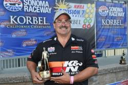 Steve posing with his trophy after a win in Sonoma, Calif., on July 22