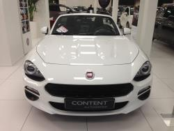 The hood bulges and headlight shape harken back to the 1966-1978 Fiat 124 Spider
