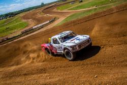 Andrew Carlson races an off-road track at a TORC series event