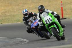 Akkaya guides a student into a turn at Superbike-Coach