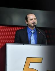 Photo of Martin speaking at the 50th Annual SEMA Banquet upon receiving the Person of the Year honor