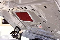 A K&N panel filter from a ZR1 Corvette is utilized to best fit the available space