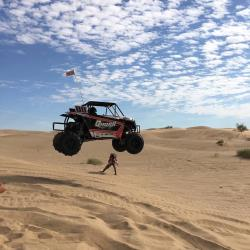 Queen Racing of Lake Havasu City, Arizona jumping a UTV in the dunes