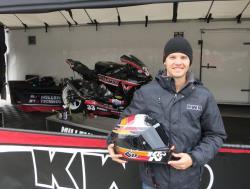 Kyle Wyman holding his K&N race helmet