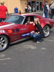 Photo of Mike & Brianne Maier talking business and race strategy at Goodguys Pleasanton