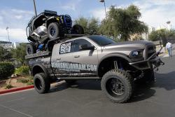 A Polaris RZR rides piggyback in the bed of the Ram pickup truck