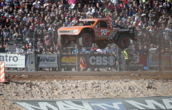 Flying through the air in front of the huge crowd while leading the Pro4 race