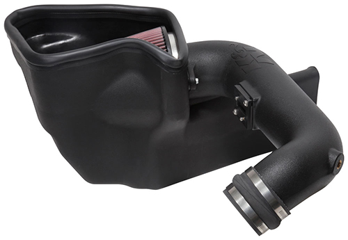A roto-molded air box design utilizes the contours of the hood