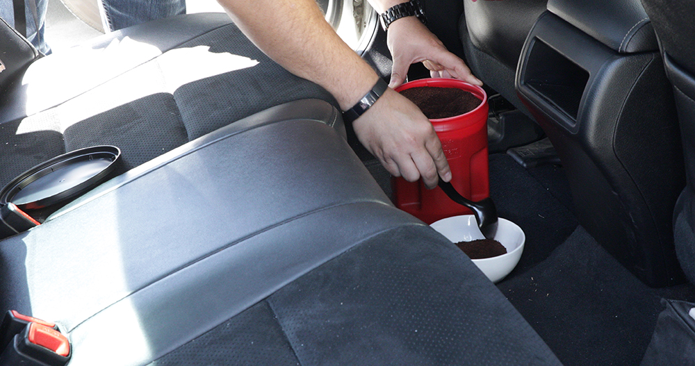 Coffee grounds in vehicle cabin