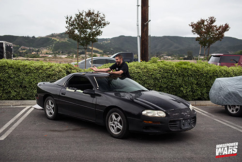 Man with a black vehicle