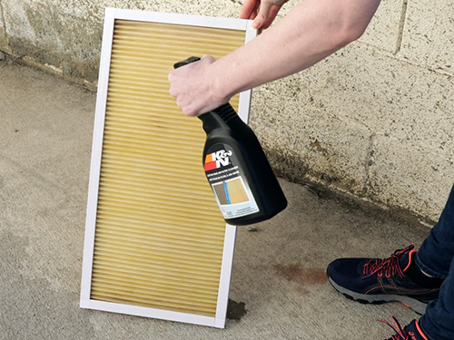 Lightly spray filter cleaner onto the filter before reinstalling